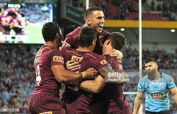 Dane Gagai of the Maroons celebrates scoring a try with Darius Boyd and Justin O'Neill during game two of the State Of Origin series between the...