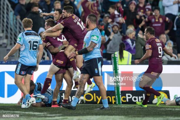 Dane Gagai of the Maroons celebrates with his team mates Michael Morgan Billy Slater Matt Gillett and Cameron Smith of the Marrons after scoring a...