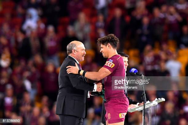 Dane Gagai of the Maroons is presented with the Wally Lewis Medal for player of the series by former Queensland Origin player Wally Lewis after game...