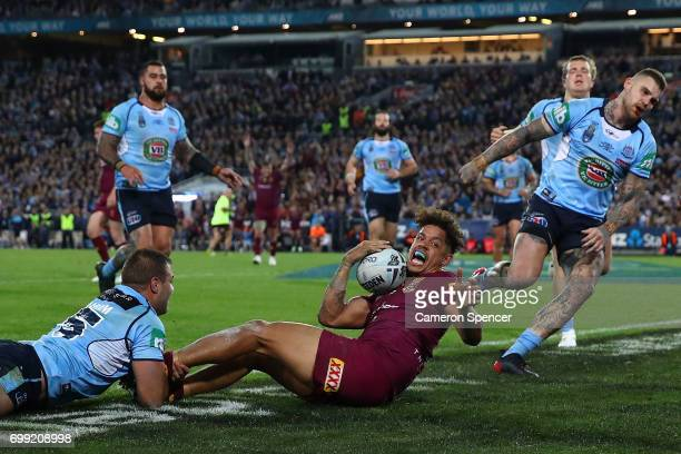 Dane Gagai of the Maroons scores a try during game two of the State Of Origin series between the New South Wales Blues and the Queensland Maroons at...
