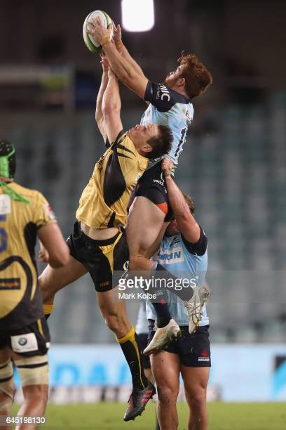 Dane HaylettPetty of the Force and Andrew Kellaway of the Waratahs compete for the ball during the round one Super Rugby match between the Waratahs...
