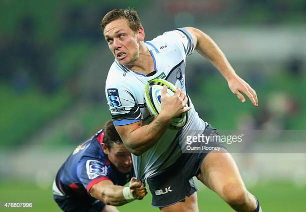 Dane HaylettPetty of the Force breaks through atackle by Mike Harris of the Rebels during the round 18 Super Rugby match between the Rebels and the...