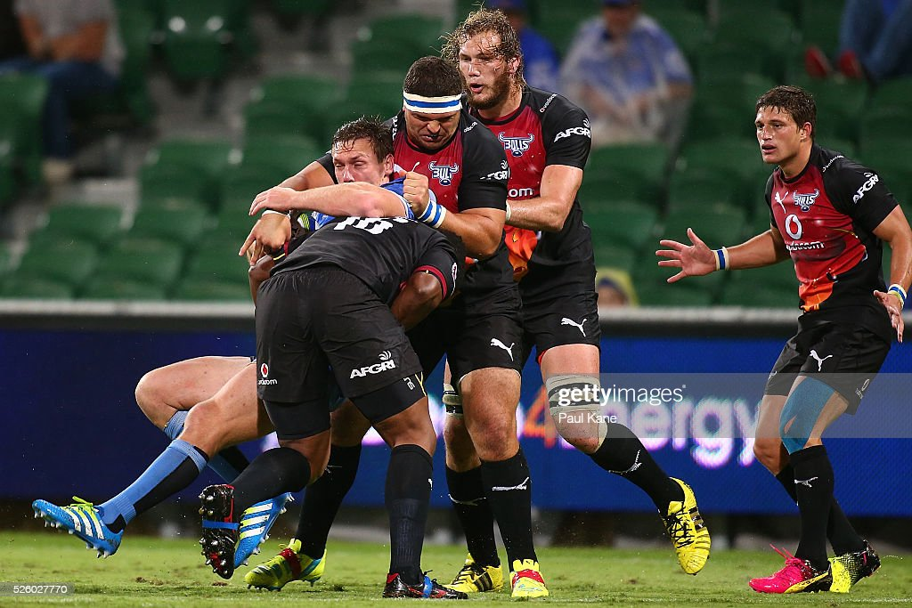 Dane Haylett-Petty of the Force gets tackled by Bandise Maku and Werner Kruger of the Bulls during the round 10 Super Rugby match between the Force and the Bulls at nib Stadium on April 29, 2016 in Perth, Australia.