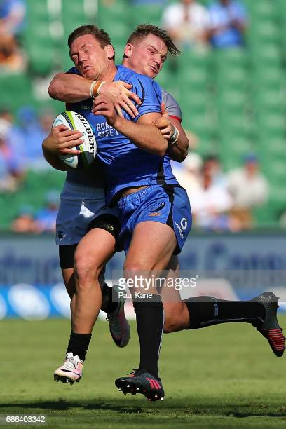 Dane HaylettPetty of the Force gets tackled by Christopher Cloete of the Kings during the round seven Super Rugby match between the Force and the...