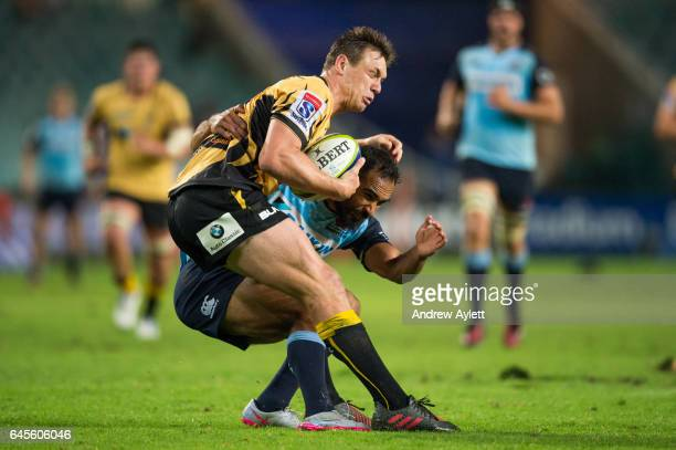 Dane HaylettPetty of the Force is tackled by Reece Robinson of Waratahs during the round 1 Super Rugby match between the Waratahs and the Force at...