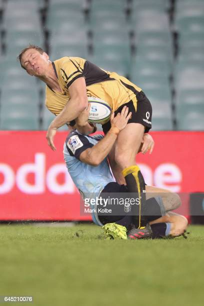 Dane HaylettPetty of the Force is tackled by Rob Horne of the Waratahs during the round one Super Rugby match between the Waratahs and the Force at...