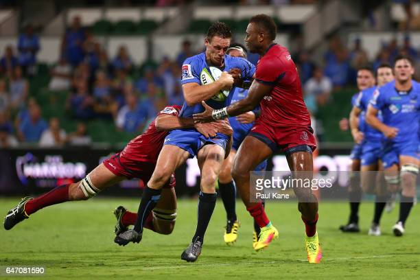 Dane HaylettPetty of the Force looks to break from a tackle by Rob Simmons and Eto Nabuli of the Reds during the round two Super Rugby match between...