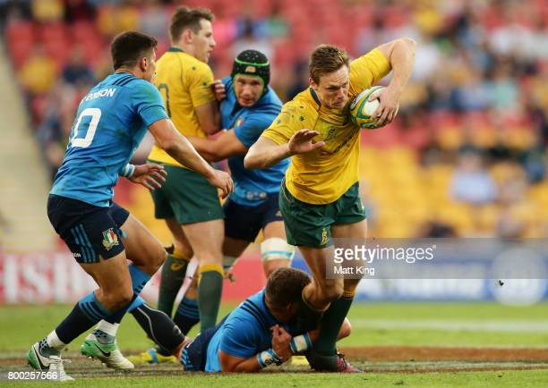 Dane HaylettPetty of the Wallabies is tackled during the International Test match between the Australian Wallabies and Italy at Suncorp Stadium on...