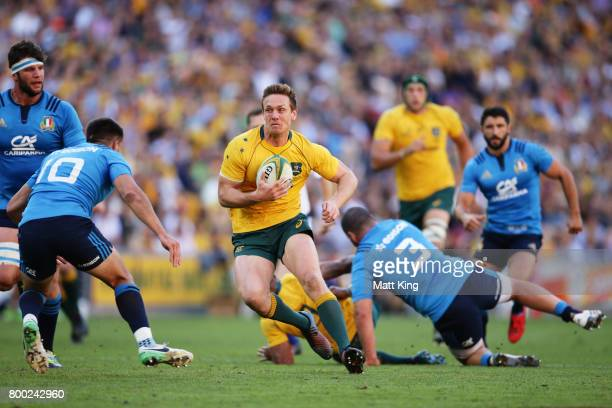 Dane HaylettPetty of the Wallabies makes a break during the International Test match between the Australian Wallabies and Italy at Suncorp Stadium on...