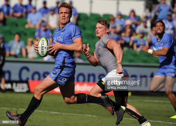 Dane HaylettPetty of the Western Force runs with the ball ahead of Christopher Cloete of the Kings during the Super Rugby match between Australias...