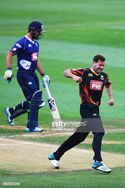 Dane Hutchinson of Wellington celebrates the wicket of Colin de Grandhomme of Auckland during the Georgie Pie Super Smash Grand Final match between...