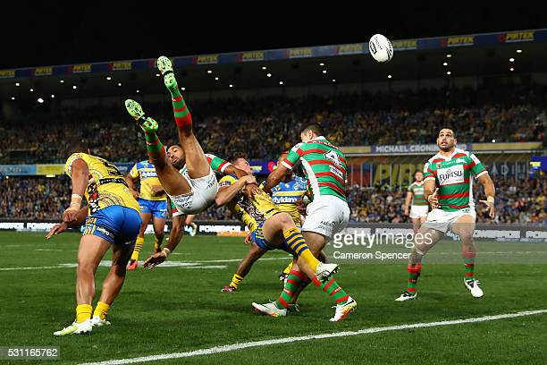 Dane Nielsen of the Rabbitohs and Clint Gutherson of the Eels contest the ball during the round 10 NRL match between the Parramatta Eels and the...