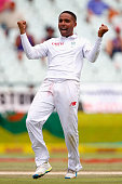 Dane Piedt of South Africa celebrates taking the wicket of Nick Compton of England during day five of the 2nd Test at Newlands Stadium on January 6...