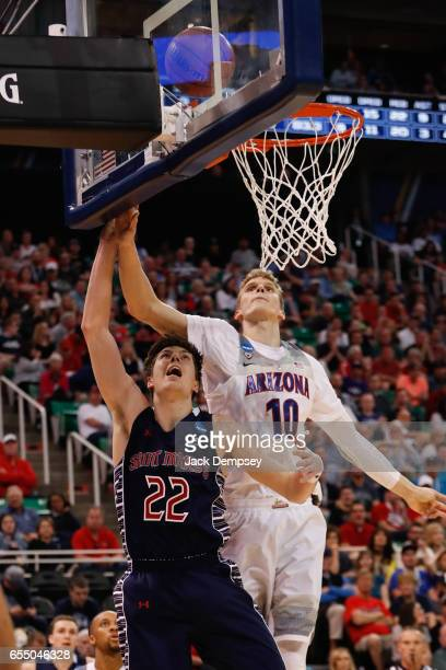 Dane Pineau of St Mary's shoots the ball around Lauri Markkanen of Arizona during the 2017 NCAA Men's Basketbal Tournament held at Vivint Smart Home...