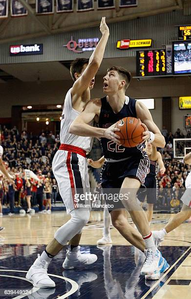 Dane Pineau of the Saint Mary's Gaels controls the ball against defender Zach Collins of the Gonzaga Bulldogs in the second half at McCarthey...
