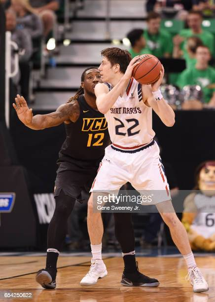 Dane Pineau of the St Mary's Gaels is defended by Mo AlieCox of the Virginia Commonwealth Rams during the first round of the 2017 NCAA Men's...