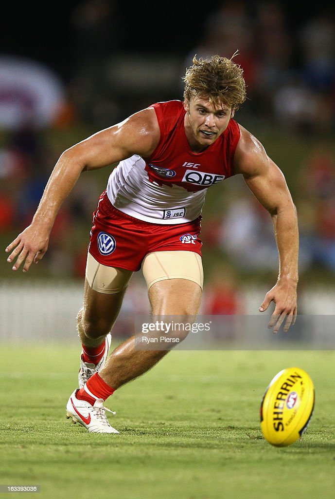 Dane Ramp of the Swans gathers the ball during the round three NAB Cup AFL match between the Sydney Swans and the Gold Coast Suns at Blacktown International Sportspark on March 9, 2013 in Sydney, Australia.