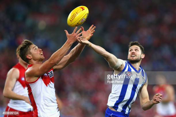 Dane Rampe of the Swans and Aaron Black of the Kangaroos compete for the ball during the 1st Preliminary Final AFL match between the Sydney Swans and...
