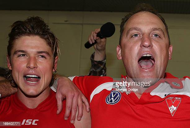 Dane Rampe of the Swans and coach John Longmire celebrate the win during an AFL match between the Collingwood Magpies and the Sydney Swans at...