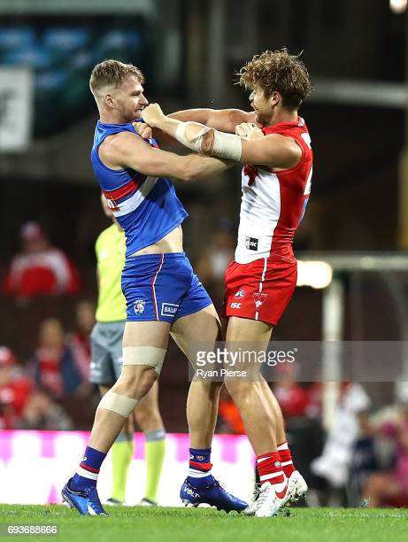 Dane Rampe of the Swans clashes with Jake Stringer of the Bulldogs during the round 12 AFL match between the Sydney Swans and the Western Bulldogs at...