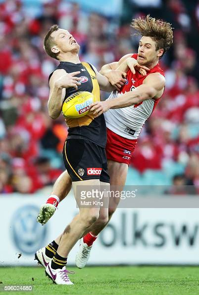 Dane Rampe of the Swans competes for the ball against Jack Riewoldt of the Tigers during the round 23 AFL match between the Sydney Swans and the...