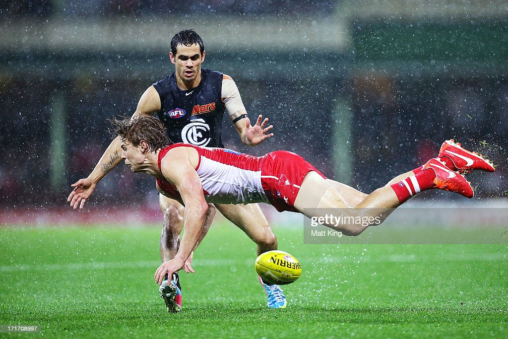 Dane Rampe of the Swans is challenged by Jeff Garlett of the Blues during the round 14 AFL match between the Sydney Swans and the Carlton Blues at SCG on June 28, 2013 in Sydney, Australia.