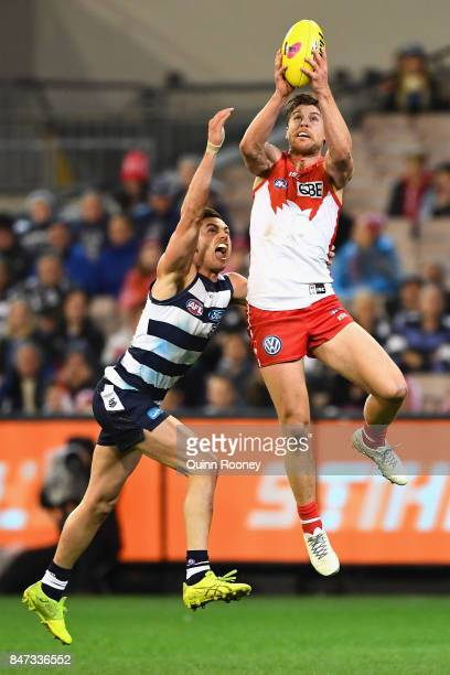 Dane Rampe of the Swans marks infront of Daniel Menzel of the Cats during the Second Semi Final AFL match between the Geelong Cats and the Sydney...