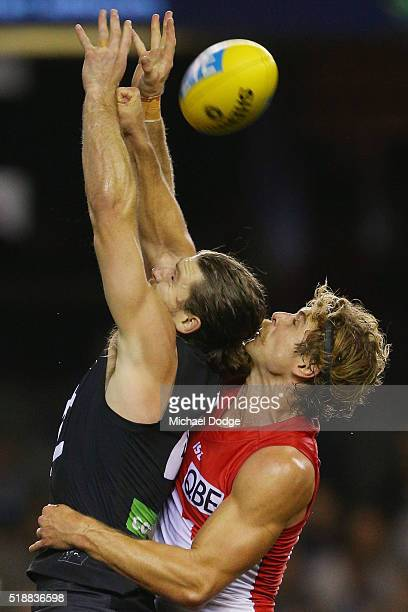 Dane Rampe of the Swans spoils Bryce Gibbs of the Blues during the round two match between the Carlton Blues and Sydney Swans at Etihad Stadium on...