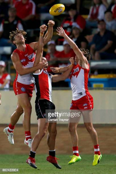 Dane Rampe of the Swans spoils Maverick Weller of the Saints during the JLT Community Series AFL match between the St Kilda Saints and the Sydney...
