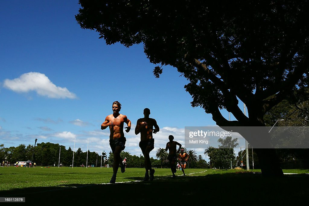 Dane Rampe (L) runs during a Sydney Swans AFL training session at Lakeside Oval on March 5, 2013 in Sydney, Australia.