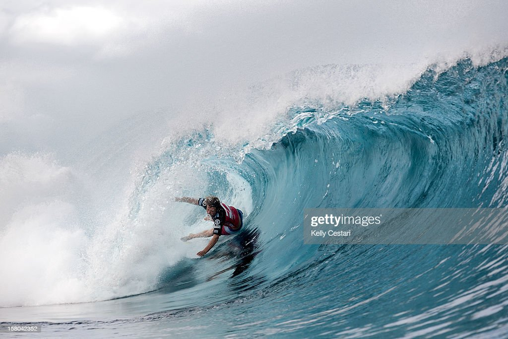 Dane Reynolds of the United States wipes out inside a Pipeline barrel en route to winning his Billabong Pipe Masters Round 2 heat on December 9, 2012 in North Shore, Hawaii.