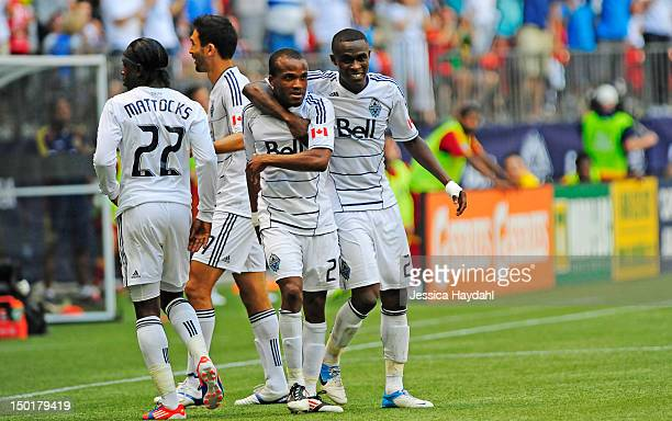 Dane Richards celebrates his second half goal with teammates Gershon Koffie Darren Mattocks and Martin Bonjour of the Vancouver Whitecaps during...