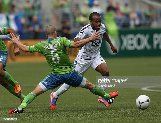Dane Richards of the Vancouver Whitecaps dribbles against the Seattle Sounders FC at CenturyLink Field on August 18 2012 in Seattle Washington
