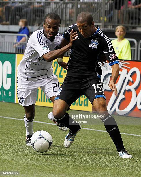 Dane Richards of the Vancouver Whitecaps FC and Justin Morrow of the San Jose Earthquakes battle for the ball during their MLS game July 22 2012 at...