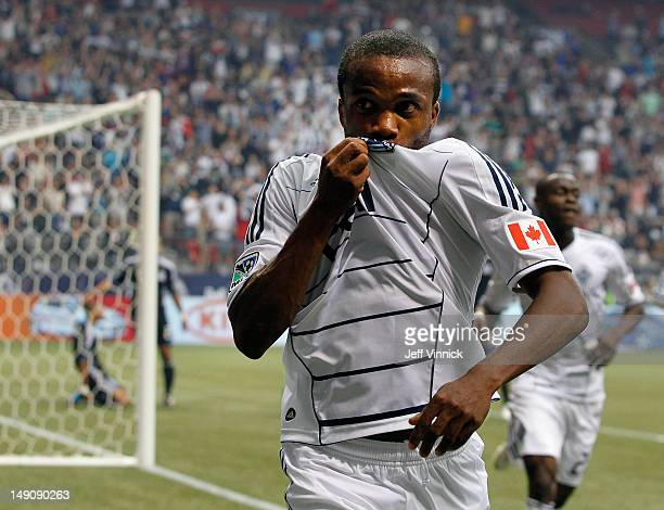 Dane Richards of the Vancouver Whitecaps FC kisses his jersey after scoring during their MLS game against the San Jose Earthquakes July 22 2012 at BC...