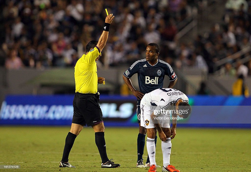 Dane Richards #20 of the Vancouver Whitecaps looks at referee Baldomero Toledo as Toledo books Richards with a yellow card during the MLS match at The Home Depot Center on September 1, 2012 in Carson, California. The Galaxy defeated the Whitecaps 2-0.