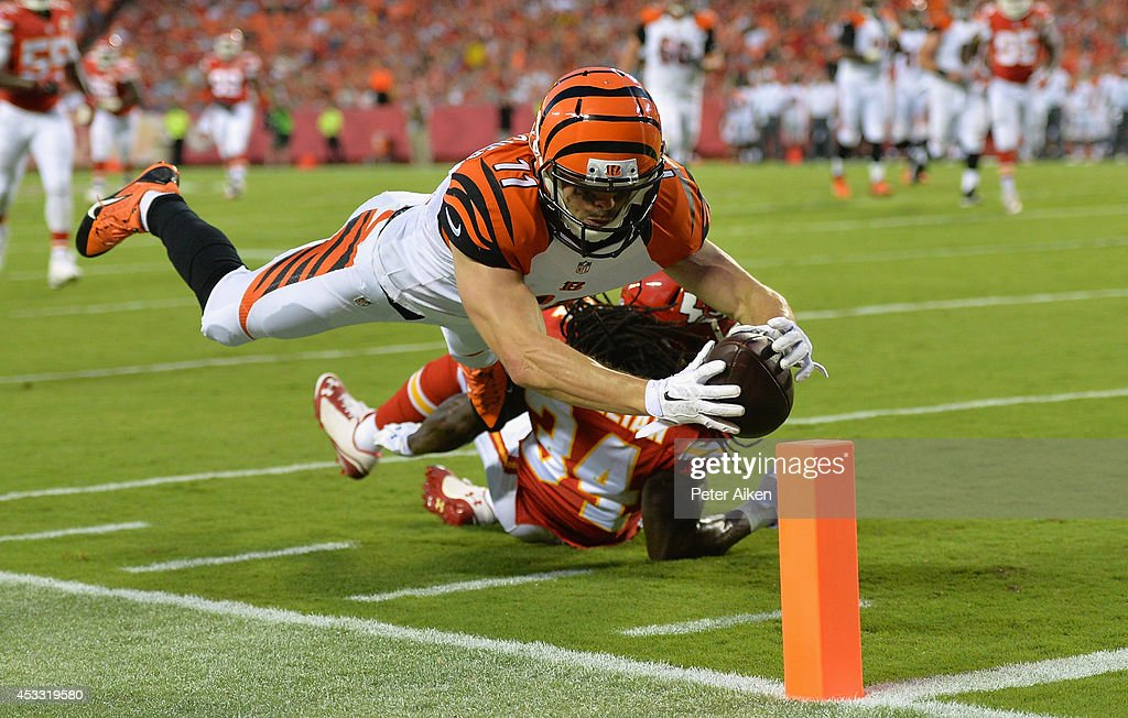 <a gi-track='captionPersonalityLinkClicked' href=/galleries/search?phrase=Dane+Sanzenbacher&family=editorial&specificpeople=4479929 ng-click='$event.stopPropagation()'>Dane Sanzenbacher</a> #11 of the Cincinnati Bengals scores a touchdown against Jerron McMillian #34 of the Kansas City Chiefs at Arrowhead Stadium on August 7, 2014 in Kansas City, Missouri.