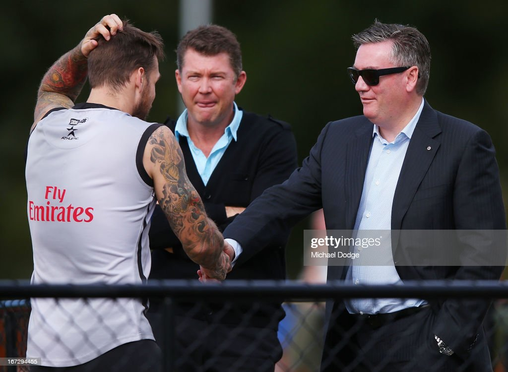 Dane Swan and President Eddie McGuire shake hands during a Collingwood Magpies AFL training session at Olympic Park on April 24 2013 in Melbourne...