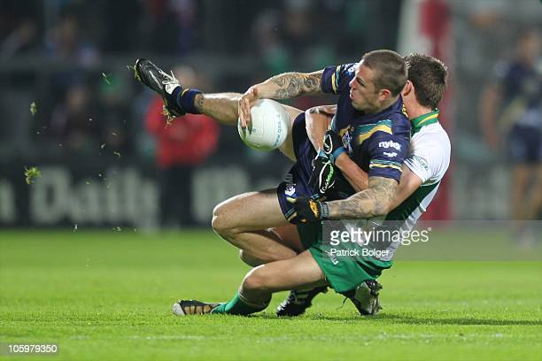 Dane Swan of Australia and Colm Begley of Ireland in action during the International Rules series First Test between Ireland and Australia at the...