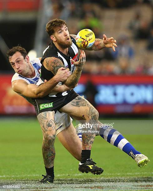 Dane Swan of the Magpies is tackled by Todd Goldstein of the Kangaroos during the round nine AFL match between the Collingwood Magpies and the North...