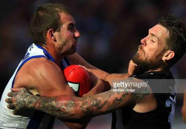 Dane Swan of the Magpies tackles Ben Cunnington of the Kangaroos during the round five AFL match between the Collingwood Magpies and the North...