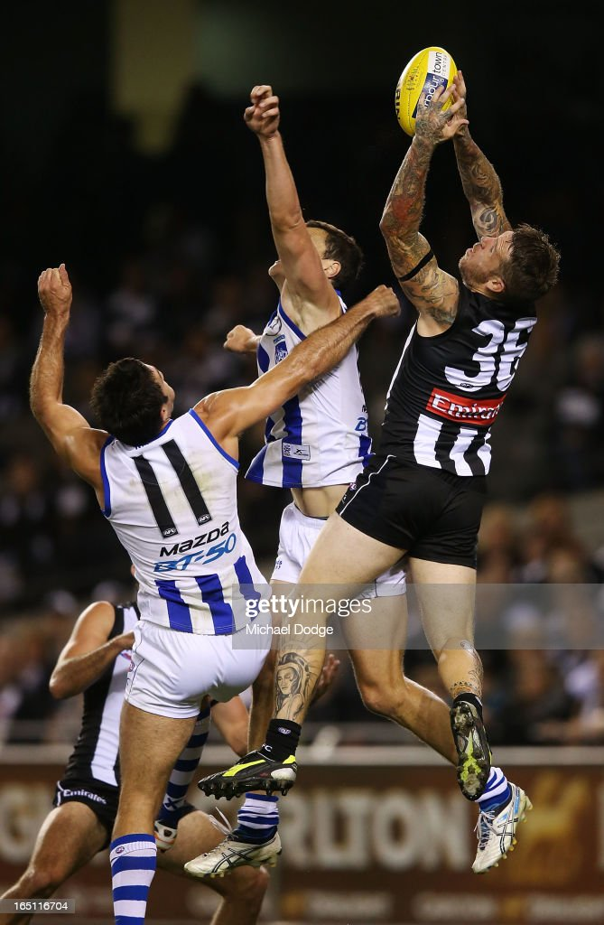 <a gi-track='captionPersonalityLinkClicked' href=/galleries/search?phrase=Dane+Swan&family=editorial&specificpeople=596987 ng-click='$event.stopPropagation()'>Dane Swan</a> of the Magpies takes a high mark during the round one AFL match between the North Melbourne Kangaroos and Collingwood Magpies at Etihad Stadium on March 31, 2013 in Melbourne, Australia.