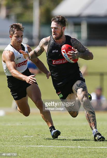 Dane Swan runs with the ball away from Ben Kennedy during a Collingwood Magpies AFL training session at Olympic Park on January 23 2015 in Melbourne...