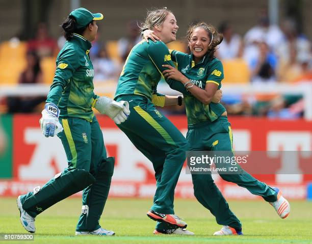 Dane van Niekerk of South Africa celebrates bowling Mithali Raj of India with Shabnim Ismail during the ICC Women's World Cup 2017 match between...