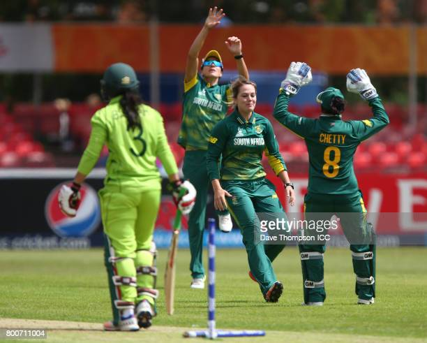 Dane van Niekerk of South Africa celebrates with wicket keeper Trisha Chetty of South Africa after she stumped Bismah Maroof of Pakistan during the...