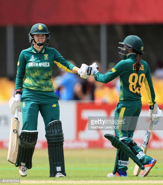 Dane van Niekerk of South Africa is congratulated on her half century by Shabnim Ismail during the ICC Women's World Cup 2017 match between South...