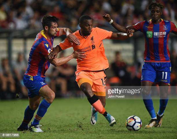 Daneil Sturridge of Liverpool competes with Scott Dann of Crystal Palace during the Premier League Asia Trophy match between Liverpool FC and Crystal...