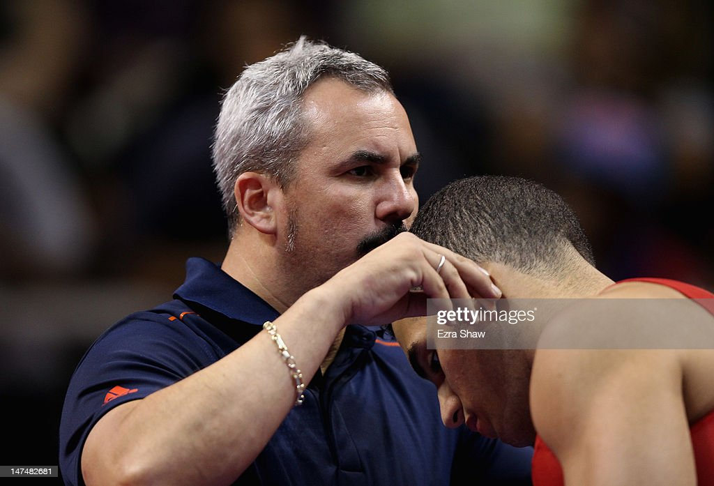 <a gi-track='captionPersonalityLinkClicked' href=/galleries/search?phrase=Danell+Leyva+-+Gymnast&family=editorial&specificpeople=5069666 ng-click='$event.stopPropagation()'>Danell Leyva</a> is kissed by coach Yin Alvarez before competing on the rings on the high bar during day 3 of the 2012 U.S. Olympic Gymnastics Team Trials at HP Pavilion on June 30, 2012 in San Jose, California.
