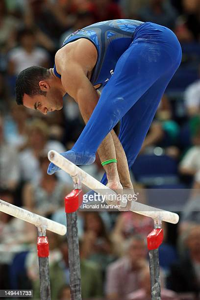 Danell Leyva of the United States of America competes in the parrallel bars in the Artistic Gymnastics Men's Team qualification on Day 1 of the...