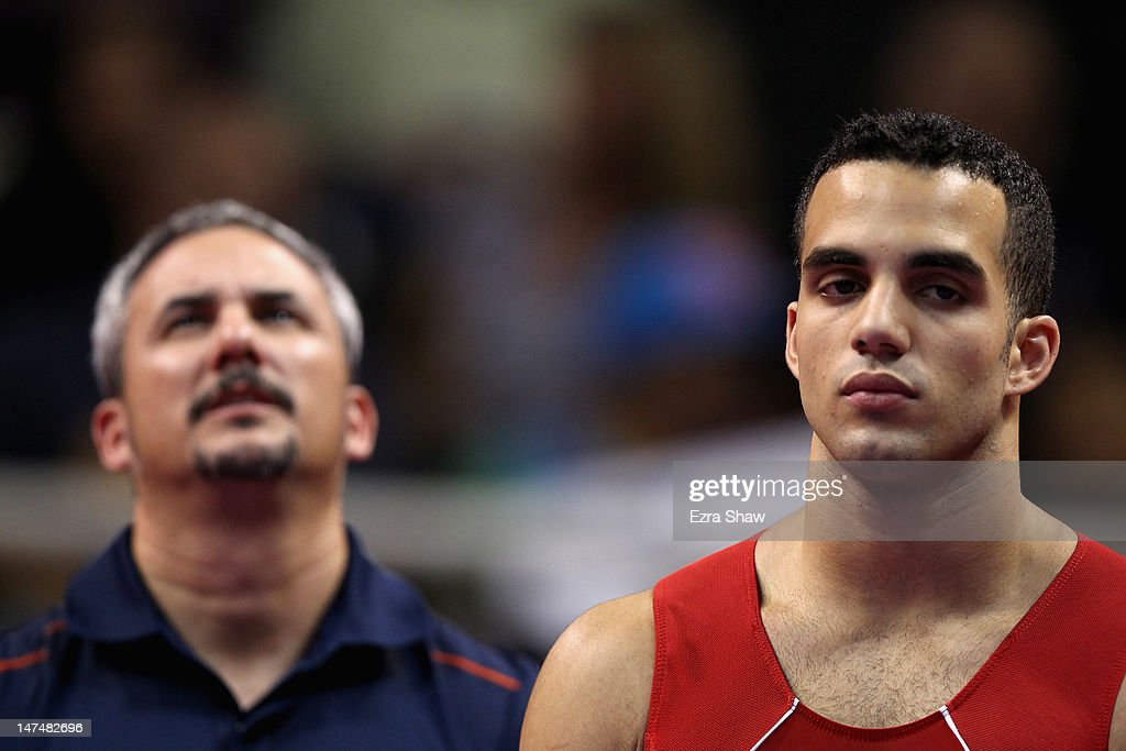 <a gi-track='captionPersonalityLinkClicked' href=/galleries/search?phrase=Danell+Leyva+-+Gymnast&family=editorial&specificpeople=5069666 ng-click='$event.stopPropagation()'>Danell Leyva</a> stands in front of his coach Yin Alvarez before competing on the rings on the high bar during day 3 of the 2012 U.S. Olympic Gymnastics Team Trials at HP Pavilion on June 30, 2012 in San Jose, California.